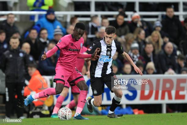 Fabio Tavares of Rochdale in action with Tom Allan of Newcastle United during the FA Cup match between Newcastle United and Rochdale at St James's...