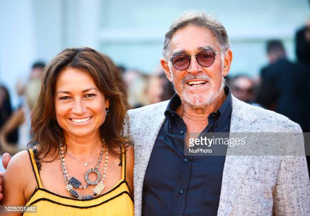 Fabio Testi walk the red carpet ahead of the opening ceremony and the 'First Man' screening during the 75th Venice Film Festival, in Venice, Italy,...