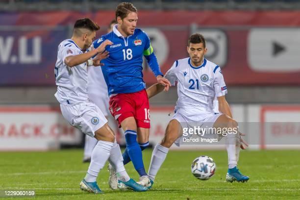 Fabio Tomassini of San Marino, Nicolas Hasler of Liechtenstein and Lorenzo Lunadei of San Marino battle for the ball during the UEFA Nations League...