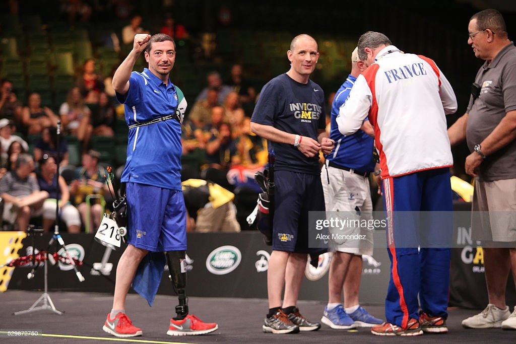 Fabio Tomasulo of France celebrates with his coach during the Invictus Games Orlando 2016 Archery Finals at the ESPN Wide World of Sports Complex on May 9, 2016 in Lake Buena Vista, Florida.