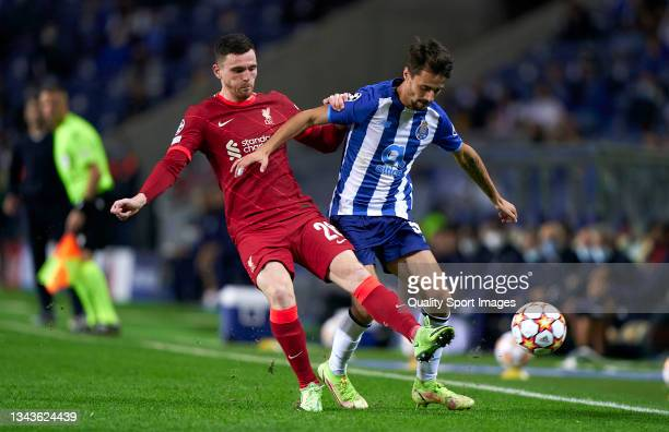 Fabio Vieira of FC Porto competes for the ball with Andrew Robertson of Liverpool FC during the UEFA Champions League group B match between FC Porto...