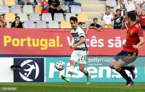 Fabio Vieira of Portugal scores their team's first goal during the 2021 UEFA European Under-21 Championship Semi-finals match between Spain and...