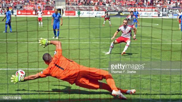 Fabio Viteritti of Cottbus scores a penalty against goalkeeper Ioannis Gelios of Rostock during the 3. Liga match between FC Energie Cottbus and F.C....