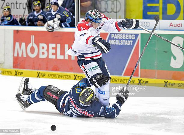 Fabio Wagner of ERC Ingolstadt and Barry Tallackson of the Eisbaeren Berlin during the game between ERC Ingolstadt and Eisbaeren Berlin on November...