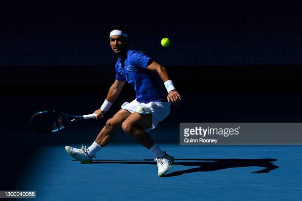 FabioFognini of Italy plays a forehand in his Group C singles match against BenoitPaire of France during day two of the 2021 ATP Cup at John Cain...