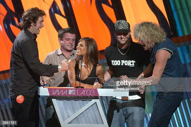 Fabiola Campomanes and Dirty Vegas speaks onstage at the MTV Video Music Awards Latin America 2003 at the Jackie Gleason Theater on October 23 2003...
