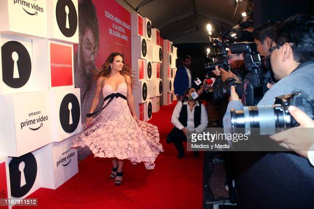 Fabiola Campomanes poses for photos as part of the red carpet of the TV show 'El Juego de las Llaves' on August 13 2019 in Mexico City Mexico