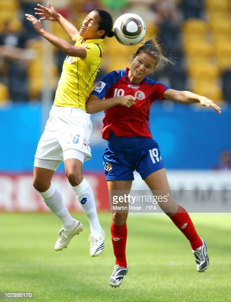Fabiola Sanchez of Costa Rica and Lady Andrade of Colombia jump for a header during the 2010 FIFA Women's World Cup Group C match between Costa Rica...