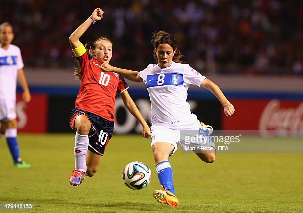 Fabiola Villalobos of Costa Rica and Flamina Simonetti of Italy battle for the ball during the FIFA U17 Women's World Cup 2014 group A match between...