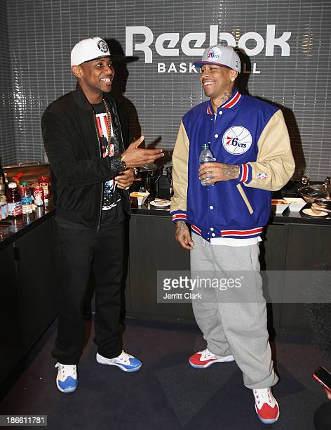 Fabolous and Allen Iverson attend the launch of the Reebok Q96 at the Miami Heat vs Brooklyn Nets game at Barclays Center on November 1 2013 in the...