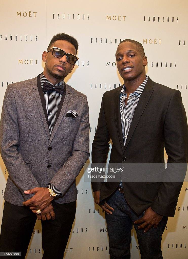 Fabolous and Moet Brand Manager Keith Howard attend the Moet Rose Lounge Chicago hosted by Fabolous at Drum Bar at the Raffaello Hotel on July 6, 2013 in Chicago, Illinois.
