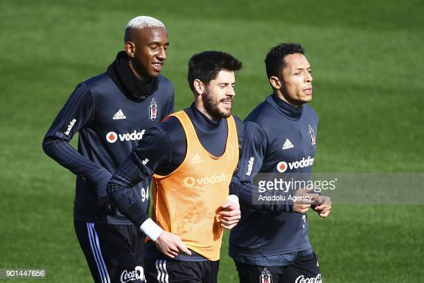 Fabri Talisca and Adriano of Besiktas attend a training session ahead of the 2nd half of the Turkish Super Lig in Antalya Turkey on January 05 2018