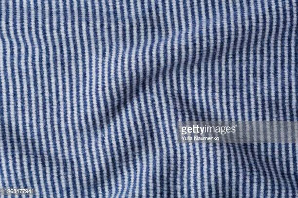fabric as a background, warm knitted fabric. - cachemire motif photos et images de collection