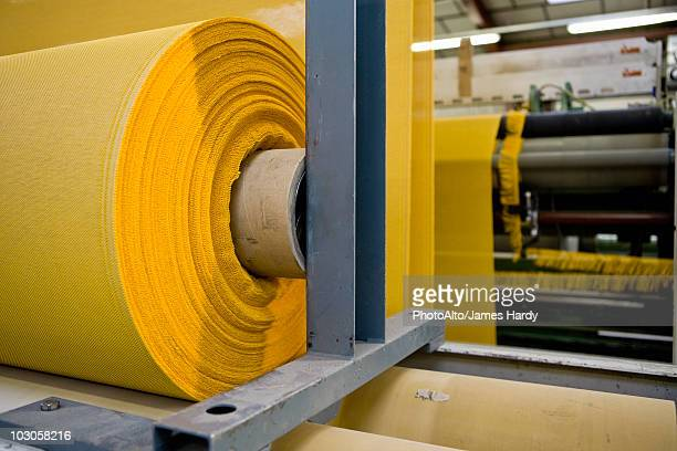 fabric coating plant, recyclable composite textile weaving department, roll of textile composite fabric - polyester stock photos and pictures