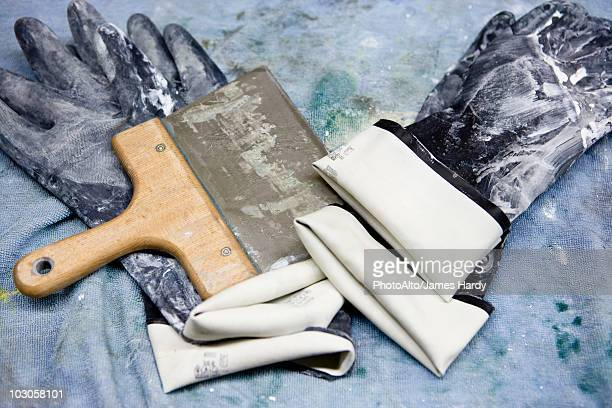 Fabric coating plant, rubber gloves and squeegee