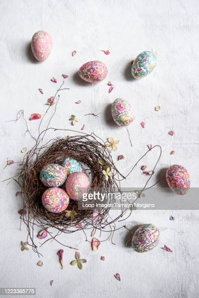fabric covered eggs in nest - easter stock pictures, royalty-free photos & images