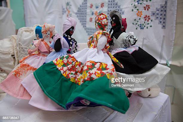 fabric dolls on display at crafts market, trinidad, cuba - cuban doll stock pictures, royalty-free photos & images