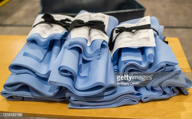 Fabric is cut for NHS uniforms as staff at Tibard begin work on a new order of 20000 nurses uniforms at their factory in Dukinfield where they...