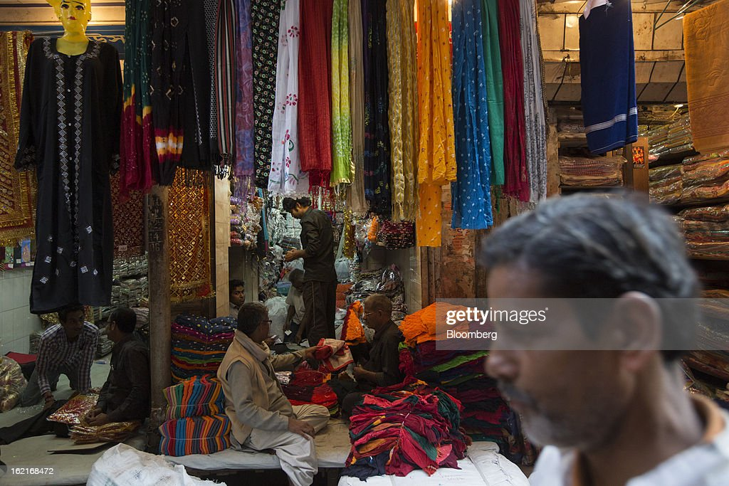 Fabric is sold at a store in the Burrabazar area of Kolkata, India, on Tuesday, Feb. 19, 2013. India's slowest economic expansion in a decade is limiting profit growth at the biggest companies even as foreigners remain net buyers of the nation's stocks, according to Kotak Institutional Equities. Photographer: Brent Lewin/Bloomberg via Getty Images