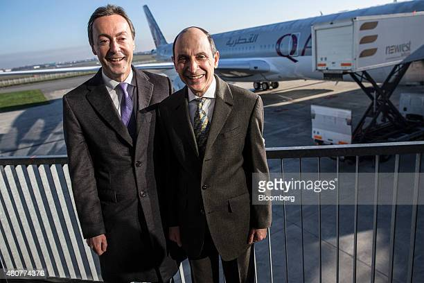 Fabrice Bregier chief executive officer of Airbus left and Akbar Al Baker chief executive officer of Qatar Airways Ltd pose for a photograph as...