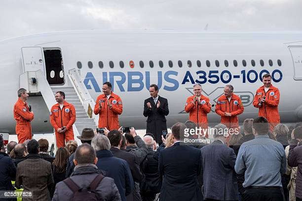 Fabrice Bregier chief executive officer of the commercial aircraft unit at Airbus Group center stands with the aircrew of the A3501000 twinjet...
