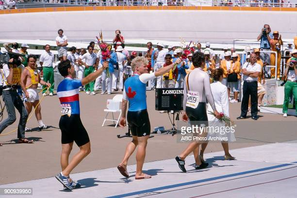 Fabrice Colas Curt Harnett Fredy Schmidtke Men's Track cycling 1 km time trial medal ceremony Olympic Velodrome at the 1984 Summer Olympics July 30...