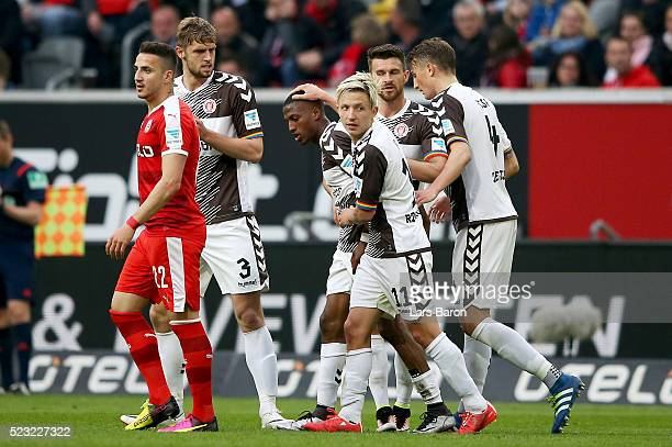 Fabrice Fafa Picault of Pauli celebrates with team mates after scoring his teams irst goal during the Second Bundesliga match between Fortuna...
