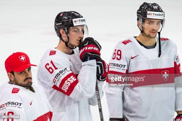 Fabrice Herzog #89 Cody Almond and Goalie Niklas Schlegel reacts after the Ice Hockey World Championship Quarterfinal between Switzerland and Sweden...