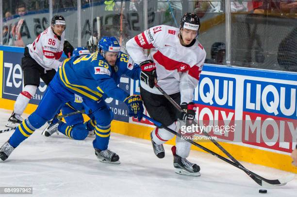 Fabrice Herzog vies with Oliver EkmanLarsson during the Ice Hockey World Championship Quarterfinal between Switzerland and Sweden at AccorHotels...