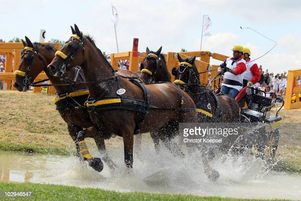 Fabrice Martin and his team of France ride during the Marathon Driving competition of the CHIO on July 17 2010 in Aachen Germany