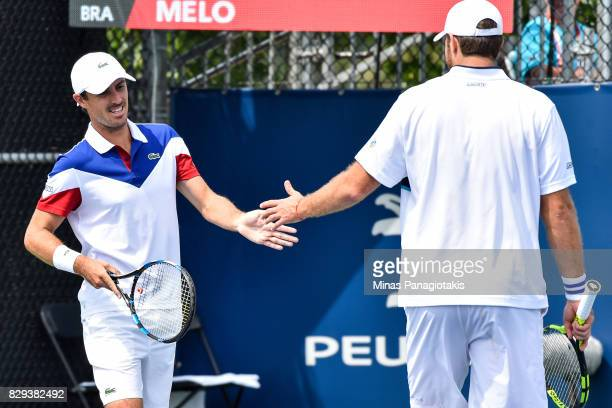 Fabrice Martin and teammate Edouard RogerVasselin of France encourage one another in their doubles match against Lukasz Kubot of Poland and teammate...