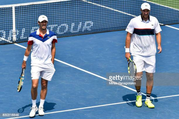 Fabrice Martin and teammate Edouard RogerVasselin of France look on in their doubles match against Raven Klaasen of Russia and Rajeev Ram of the...