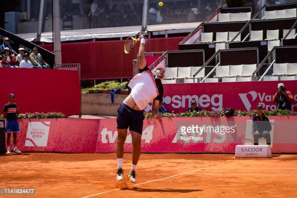 Fabrice Martin from France returns a ball to British's players Jonny O'Mara and Luke Bambridge during their Millennium Estoril Open ATP 250 Singles...