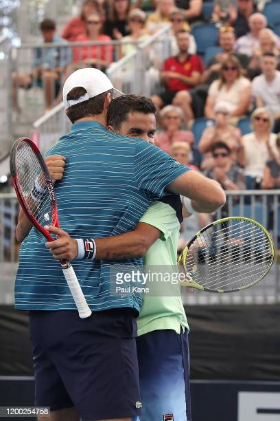 Fabrice Martin of France and Maximo Gonzalez of Argentina celebrate winning the men's doubles grand final against Ivan Dodig of Croatia and Filip...