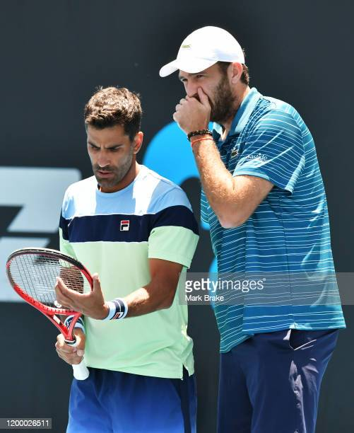 Fabrice Martin of France and Maximo Gonzalez of Argentina ialk tatics in their doubles match against Rajeev Ram of the USA Joe Salisbury of Great...