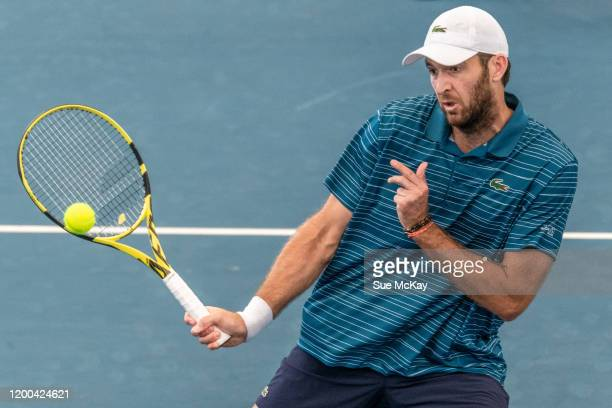 Fabrice Martin of France hits a volley in the men's doubles grand final with partner Maximo Gonzalez of Argentina against Ivan Dodig of Croatia and...
