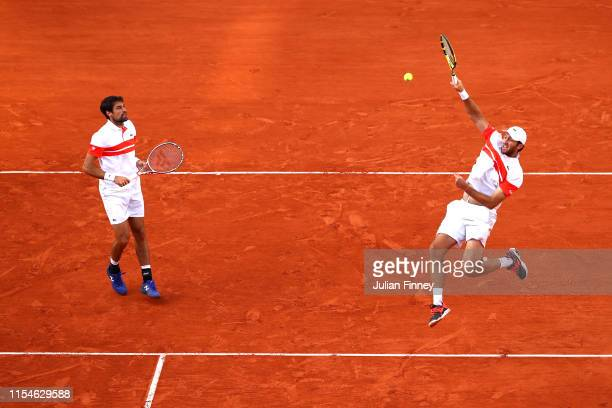 Fabrice Martin of France partner of Jeremy Chardy of France plays a smash during the mens doubles final against Kevin Krawietz of Germany and partner...