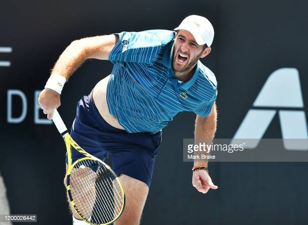 Fabrice Martin of France serves Maximo Gonzalez of Argentina in his doubles match against Rajeev Ram of the USA Joe Salisbury of Great Britain and...