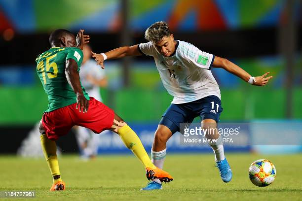 Fabrice Mezama of Cameroon tackles Exequiel Zeballos of Argentina during the FIFA U17 World Cup Brazil 2019 group E match between Cameroon and...