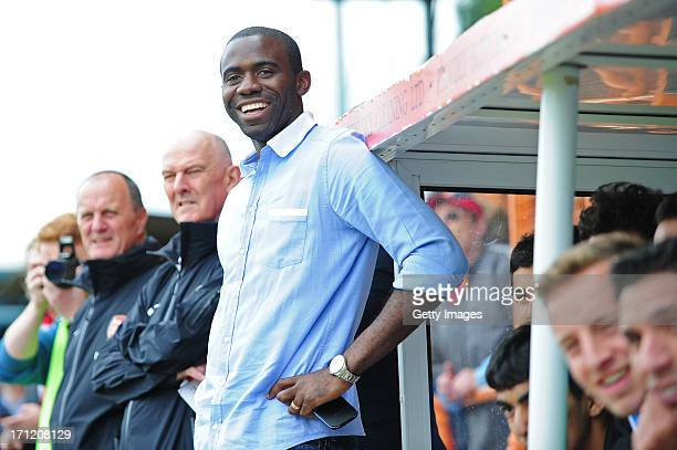 Fabrice Muamba manager of World Refugee Internally Displaced Persons XI looks on from the dugout during the charity football match between Arsenal...