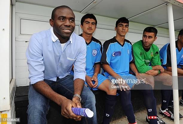 Fabrice Muamba manager of World Refugee XI looks on from the bench during a charity football match between Arsenal Legends XI and World Refugee...