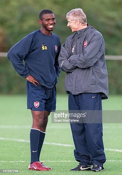 Fabrice Muamba of Arsenal and manager Arsene Wenger at the Arsenal Training Ground on November 1 2005 in London England
