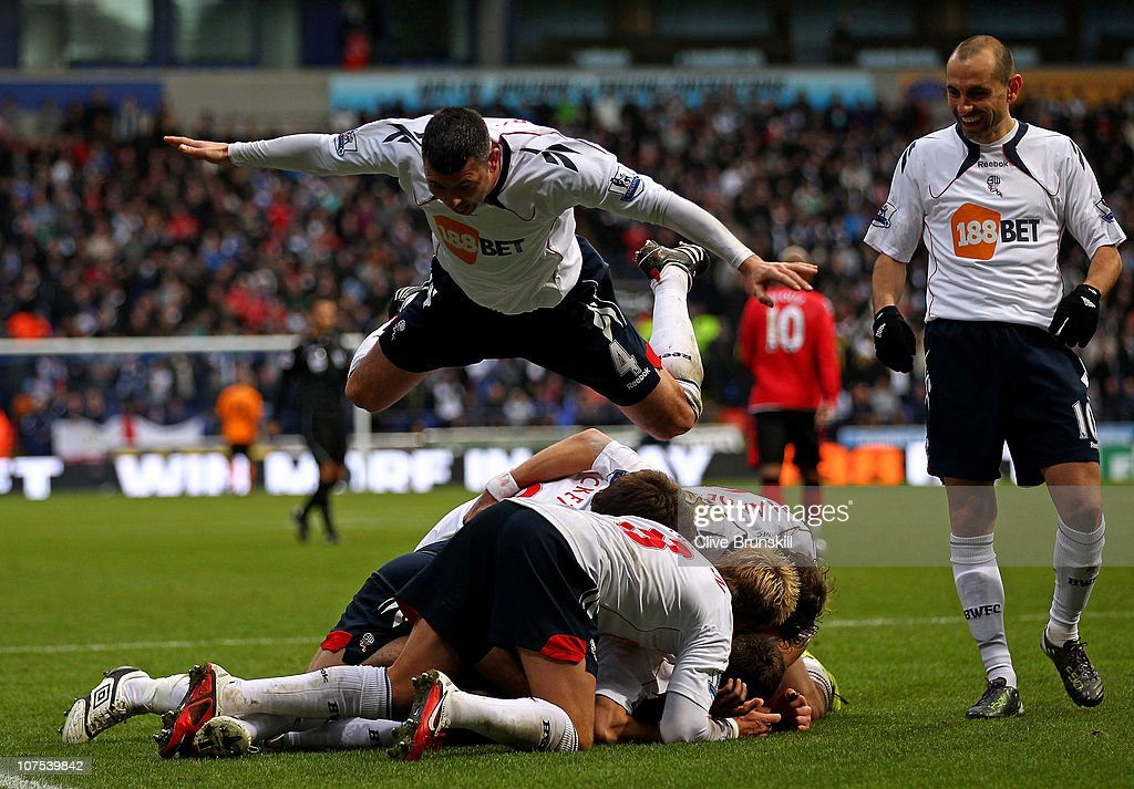 Fabrice Muamba of Bolton Wanderers celebrates scoring the opening goal with his team mates during the Barclays Premier League match between Bolton Wanderers and Blackburn Rovers at the Reebok Stadium on December 12, 2010 in Bolton, England.