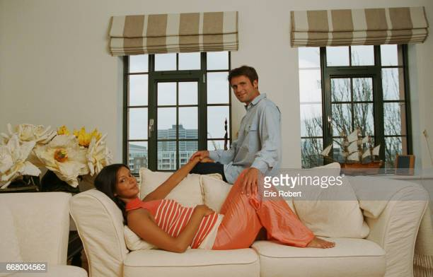 Fabrice Santora and his wife at home