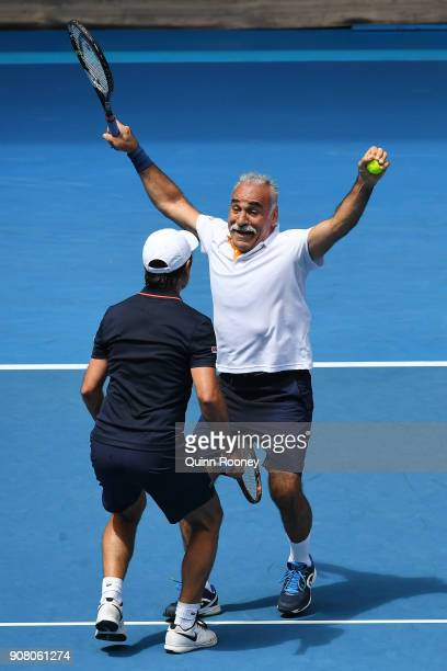 Fabrice Santoro of France and Mansour Bahrami of France celebrate winning a point in their legend's match against John McEnroe of the United States...