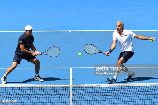 Fabrice Santoro of France and Mansour Bahrami of France compete in their legend's match against John McEnroe of the United States and Patrick McEnroe...