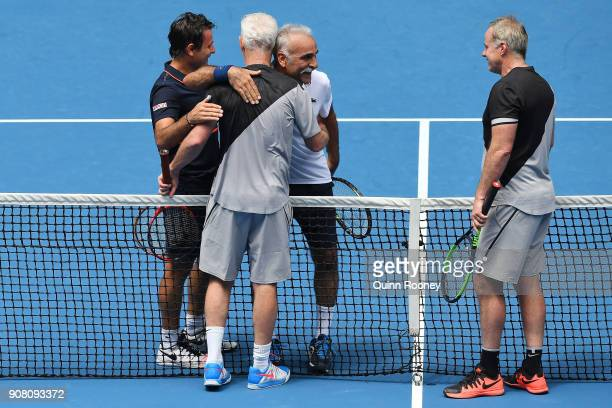 Fabrice Santoro of France and Mansour Bahrami of France congratulate John McEnroe of the United States and Patrick McEnroe of the United States after...