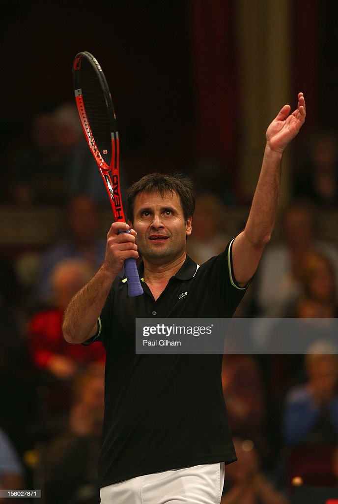 Fabrice Santoro of France celebrates winning the ATP Champions Tour Final between Tim Henman of Great Britain and Fabrice Santoro of France during the Statoil Masters Tennis at Royal Albert Hall on December 9, 2012 in London, England.