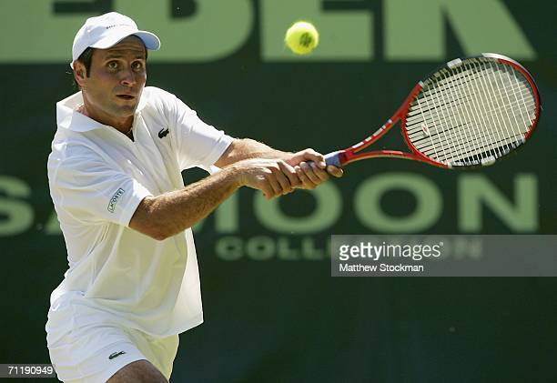 Fabrice Santoro of France returns a shot to Mikhail Youzhny of Russia June 13, 2006 during the Gerry Weber Open at Gerry Weber Stadium in Halle,...