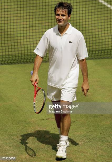 Fabrice Santoro of France walks back to the baseline after disconnecting the net sensor while playing Arnaud Clement of France June 15, 2006 during...